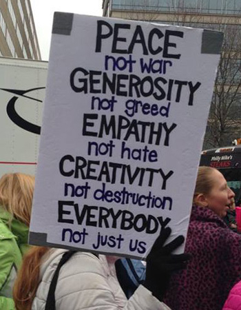 "Women's March on Washington ""peace generosity empathy creativity everybody"" sign"