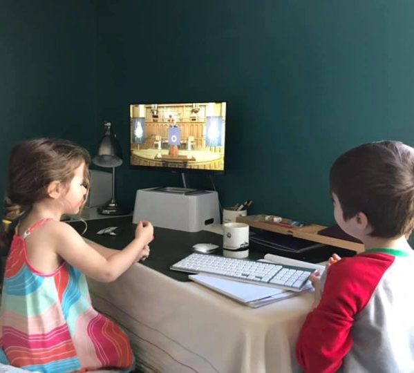 Two children joining First Church worship online